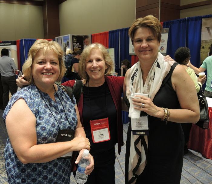 Three happy conference participants